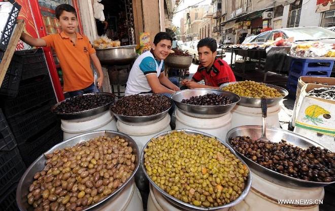 Dân Syria sống bình thản, bất chấp chiến tranh cận kề ảnh 5