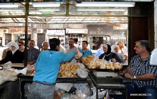 Dân Syria sống bình thản, bất chấp chiến tranh cận kề ảnh 6