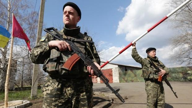 Hai phe xung đột ở Ukraine kí hiệp ước cấm các hành động quân sự ảnh 1