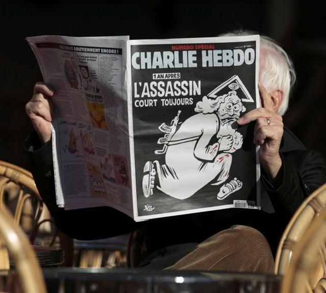 Charlie Hebdo tái xuất bản hình ảnh biếm họa nhà tiên tri Mohammed ảnh 1