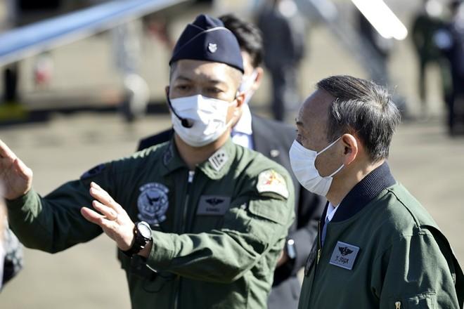 Thủ tướng Nhật Bản dự duyệt binh, kêu gọi quân đội đoàn kết ảnh 6