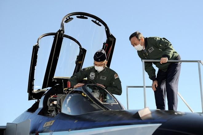 Thủ tướng Nhật Bản dự duyệt binh, kêu gọi quân đội đoàn kết ảnh 9