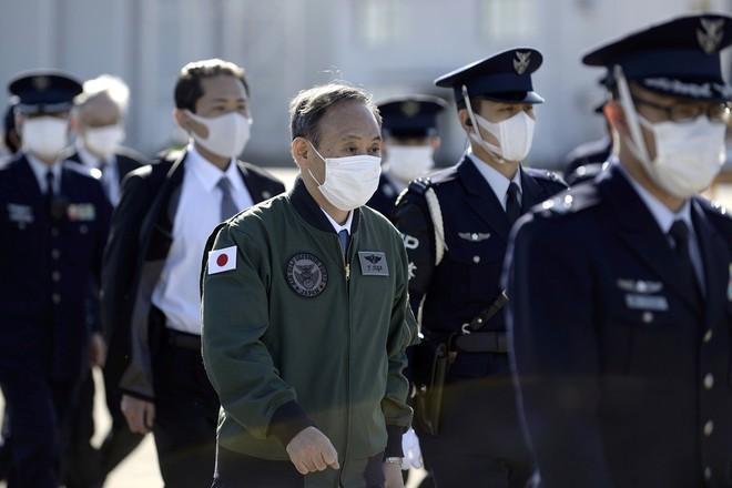 Thủ tướng Nhật Bản dự duyệt binh, kêu gọi quân đội đoàn kết ảnh 7