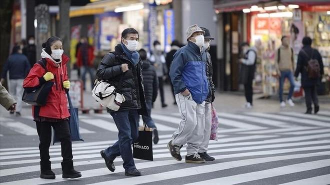 Nhật Bản mở rộng phạm vi ban bố trình trạng khẩn cấp, chấp nhận vaccine Covid-19 mới ảnh 1