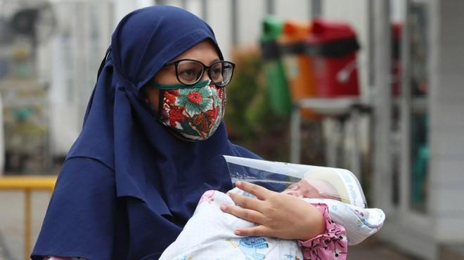 Vì sao nhiều trẻ em thiệt mạng vì nhiễm Covid-19 ở Indonesia? ảnh 1