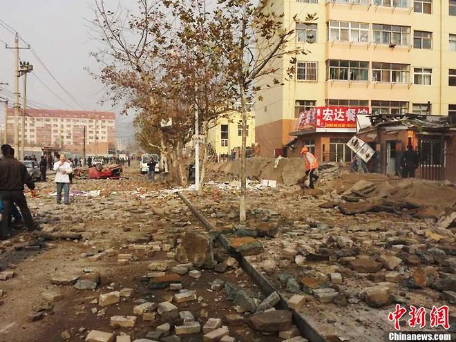 Nổ đường ống dẫn dầu Trung Quốc, 47 người chết, hàng trăm người bị thương ảnh 4