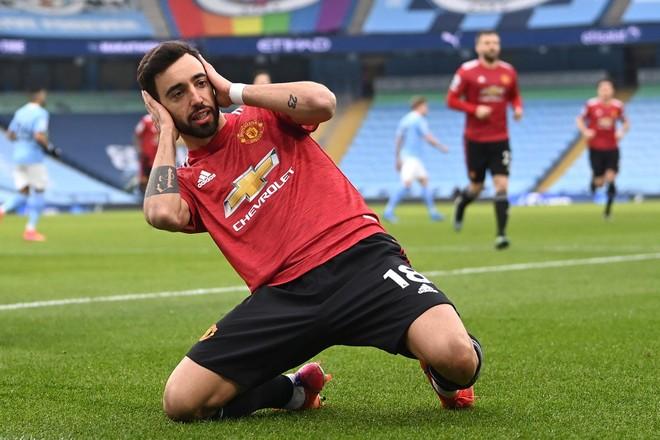 M.U xuất sắc chặn đứng mạch 21 trận thắng của Man City ảnh 1