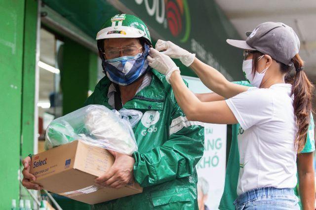 Grab sẽ hỗ trợ đối tác tài xế toàn khu vực Đông Nam Á được tiếp cận vaccine phòng Covid-19 ảnh 1