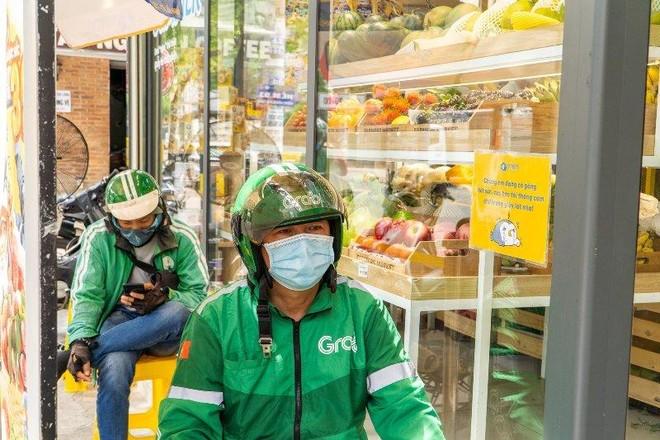 Grab tặng gói bảo hiểm Vững tâm hỗ trợ đối tác tài xế trong dịch Covid-19 ảnh 1
