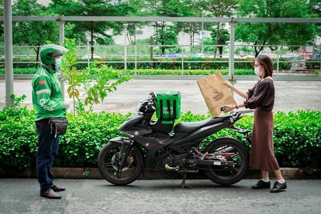 Hà Nội: Đề xuất cho shipper công nghệ được giao đồ ăn ở vùng xanh ảnh 1