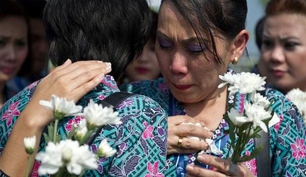 Vụ MH17: Thi thể 20 nạn nhân Malaysia đầu tiên về đến Kuala Lumpur ảnh 2