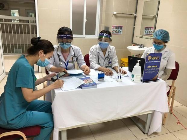 Người dân Hà Nội đăng ký tiêm chủng vaccine phòng Covid-19 thế nào? ảnh 1