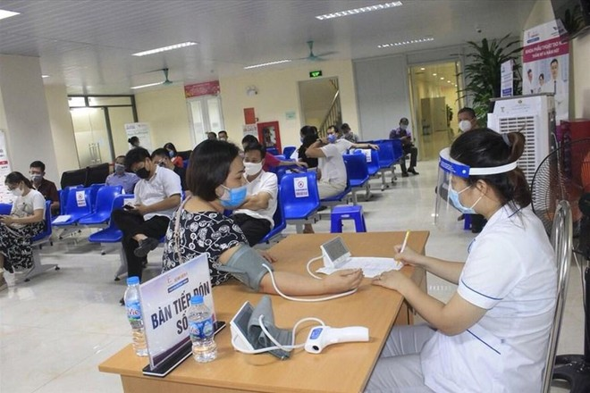 Hà Nội: Phân bổ 3 loại vaccine phòng Covid-19 cho 30 quận, huyện, thị xã ảnh 1