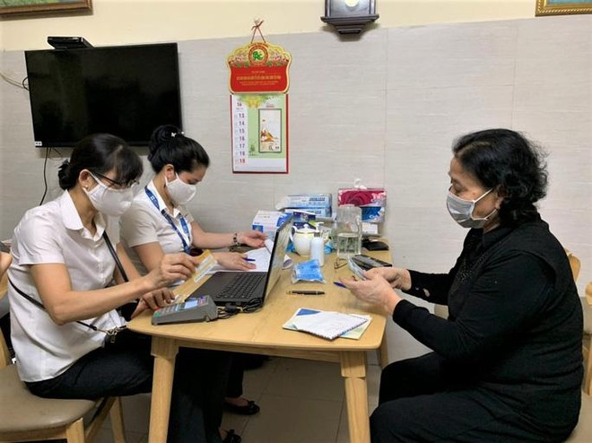 Hà Nội: Chi trả lương hưu tại nhà cho người hưởng mới từ ngày 3/8 ảnh 1