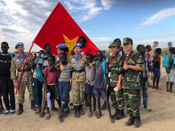 Để màu cờ Việt Nam phủ rộng hơn trên bản đồ gìn giữ hòa bình thế giới ảnh 1