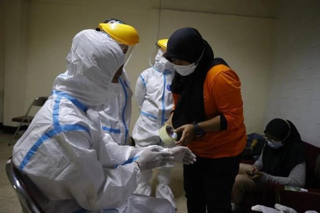 Tinh thần tình nguyện ở Indonesia - tâm dịch Covid-19 toàn cầu ảnh 1