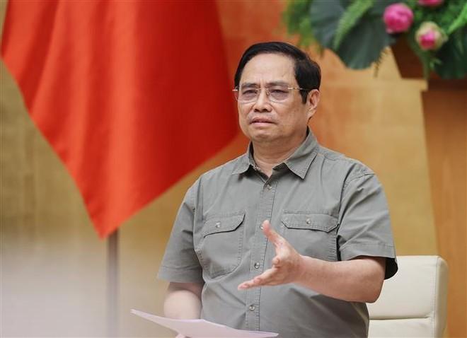 Thủ tướng Phạm Minh Chính: Tránh chủ quan, nóng vội khi mở lại các hoạt động sản xuất, kinh doanh ảnh 1