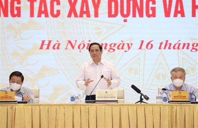 Thủ tướng Phạm Minh Chính: Chống tham nhũng, tiêu cực, lợi ích nhóm trong xây dựng và hoàn thiện thể chế ảnh 1