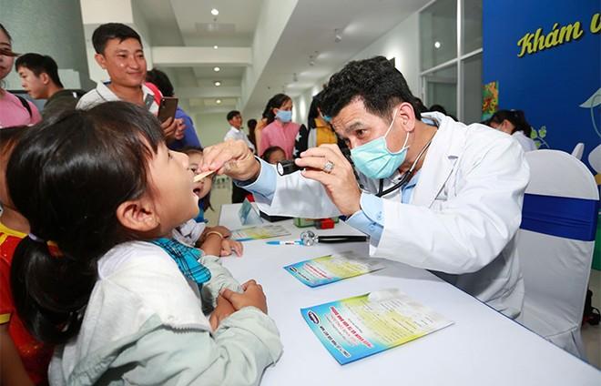 Hơn 46.300 học sinh tỉnh Vĩnh Long được thụ hưởng Sữa học đường năm học 2020-2021 ảnh 9