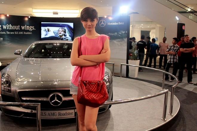 """Á quân Top model 2011 """"khoe chân"""" tại Malaysia ảnh 10"""