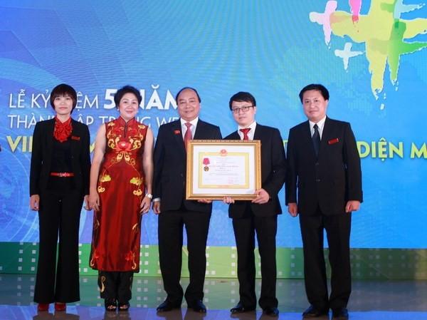 Báo điện tử Vietnam+ đón Huân chương Lao động hạng Ba ảnh 1