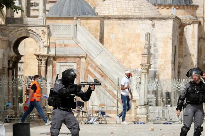 Đụng độ Israel-Palestine leo thang, hàng trăm người bị thương ảnh 1