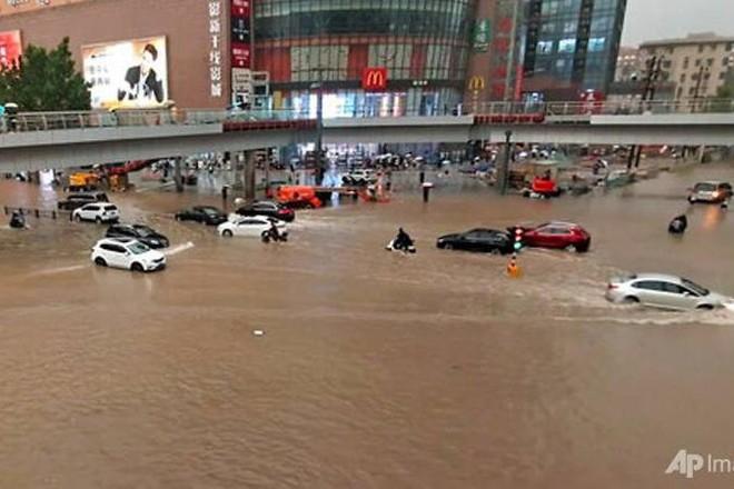 Mưa lũ tại Trung Quốc, 12 người chết ảnh 1